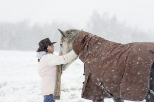 horse-and-owner-in-snow